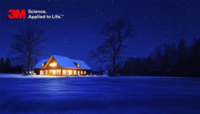 Cabin in snow on a winters night, warm on the inside because of 3M Thinsulate